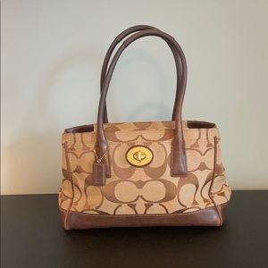 Brown and Tan Classic Coach Purse with Pink Lining